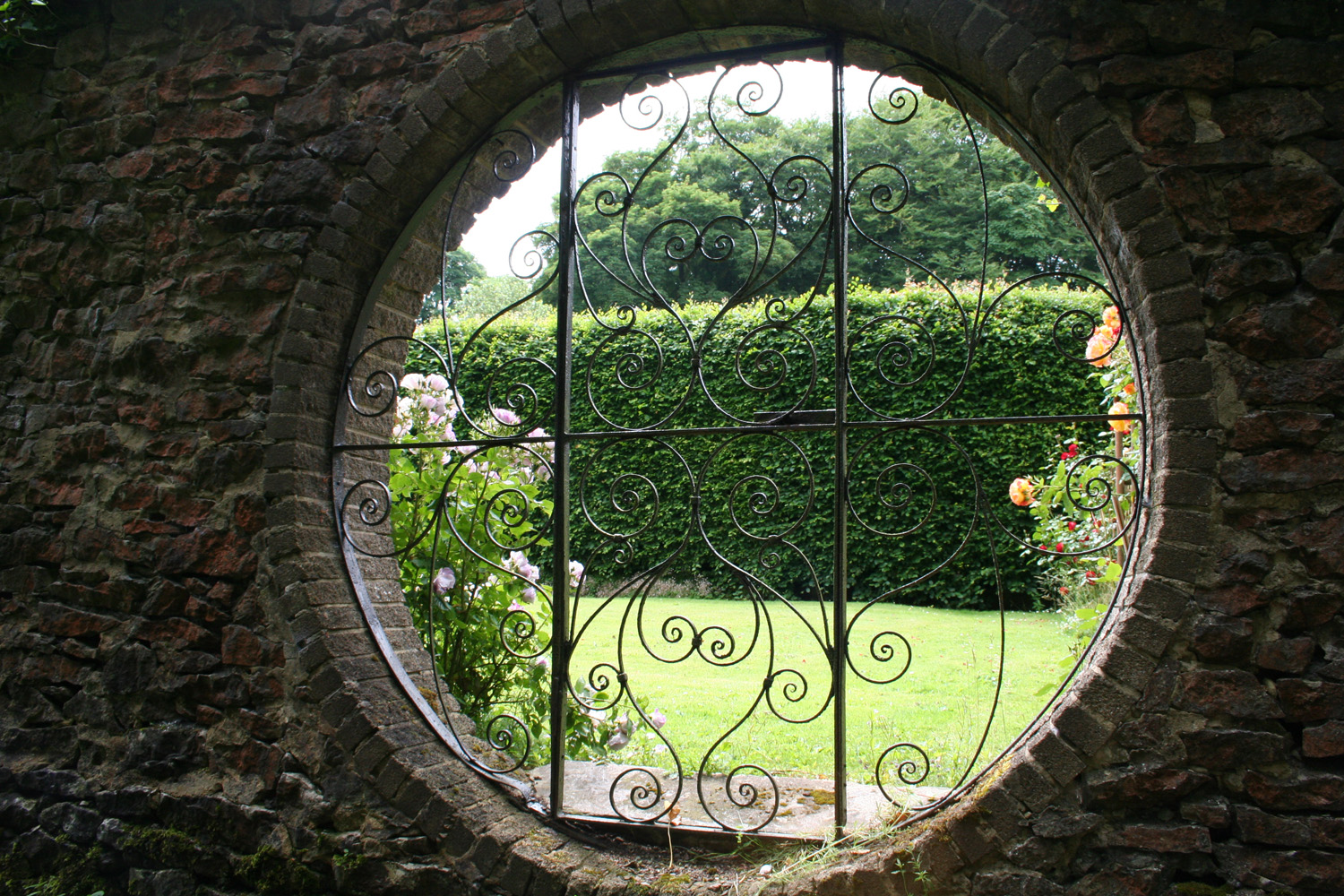 Feature gate in the garden wall.